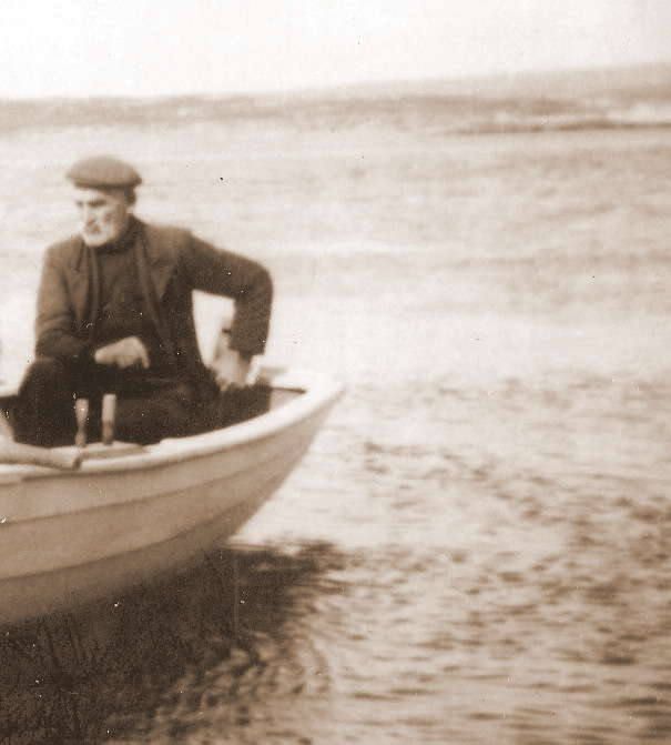 Jimmy Duffy at the helm of the Summer Star's lifeboat c1950